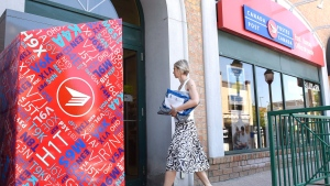 A customer arrives at a Canada Post post office on Tuesday, July 5, 2016 in Ottawa. (The Canadian Press/Justin Tang)
