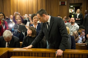 Oscar Pistorius, right, arrives inside the High Court in Pretoria, South Africa, Wednesday, July 6, 2016. (Marco Langori/Pool Photo via AP)