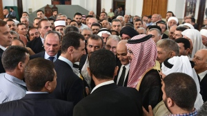 In this photo released on the official Facebook page of the Syrian Presidency, Syrian President Bashar Assad, greets people at the Safa Mosque on the first day of Eid al-Fitr, that marks the end of the Muslim holy month of Ramadan, in Homs, Syria, Wednesday, July 6, 2016. (Syrian Presidency via AP)