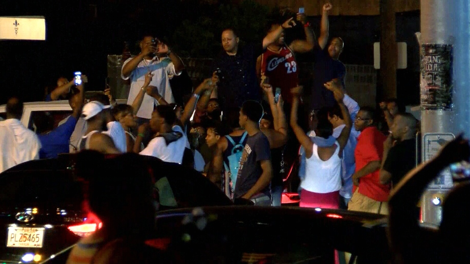 People take to the streets to protest the police shooting of Alton Sterling in Baton Rouge, La., Tuesday, July 5, 2016.