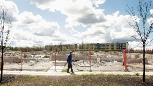 Farid El-Hayouni looks to where his house once stood in Fort McMurray, Alta. on Friday June 3, 2016. THE CANADIAN PRESS / Brian J. Gavriloff
