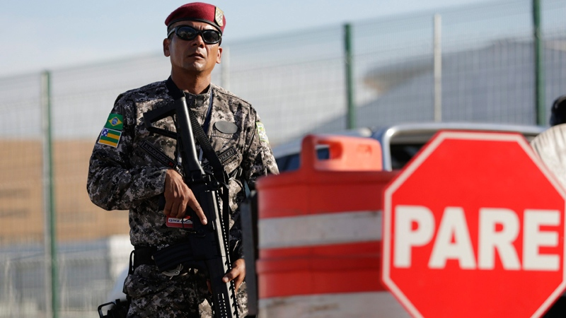 A National Security Force officer guards the entrance of the Olympic Park in Rio de Janeiro, Brazil, Tuesday, July 5, 2016. (AP / Silvia Izquierdo)