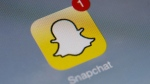 "Vanishing message app Snapchat has begun giving users the option of storing images as ""Memories"" they can look back on or share anew. (AFP PHOTO / LIONEL BONAVENTURE)"