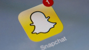 Snapchat icon on a smartphone. (AFP PHOTO / LIONEL BONAVENTURE)