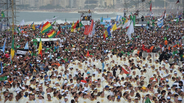 Crowds wait for the arrival of Pope Francis to celebrate Mass on the Copacabana beachfront in Rio de Janeiro, Brazil, July 28, 2013. (AP Photo/Luca Zennaro, Pool)