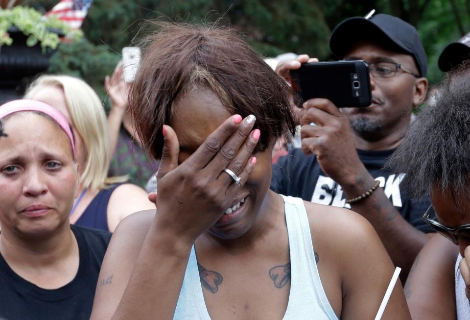 Diamond Reynolds, the girlfriend of Philando Castile of St. Paul, cries outside the governor's residence in St. Paul, Minn., on Thursday, July 7, 2016. (AP Photo/Jim Mone)