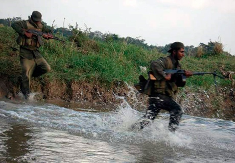 In this undated handout photo made available on Tuesday, Jan. 13, 2009 by Sri Lanka Defense Ministry, Sri lankan soldiers run in Vaddakachchi area of Sri Lanka. (AP / Sri Lanka Defense Minsitry)