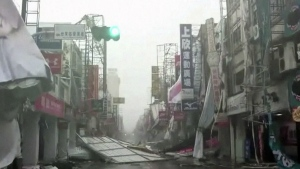 In this image made from video, wind-blown debris litters the street from Typhoon Nepartak in Taitung, south eastern Taiwan on Friday, July 8, 2016. (EBC)