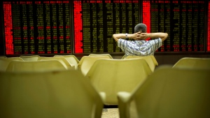 A Chinese investor monitors stock prices at a brokerage house in Beijing, Friday, June 24, 2016. (AP / Mark Schiefelbein)