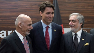 Prime Minister Justin Trudeau meets with Afghanistan President Ashraf Ghani, left, and Chief Executive of the Islamic Republic of Afghanistan Abdullah Abdullah between sessions at the NATO summit in Warsaw, Poland, on Friday, July 8, 2016. (Adrian Wyld/The Canadian Press)