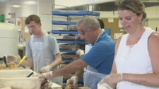 Volunteers with Sodexo prepare lunches for childre