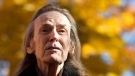 Gordon Lightfoot attends a ceremony unveiling a bronze statue in his honor at Barnfield Point, on the Gordon Lightfoot Trail in Orillia, Ont., on Oct. 23, 2015. (Fred Thornhill / THE CANADIAN PRESS)