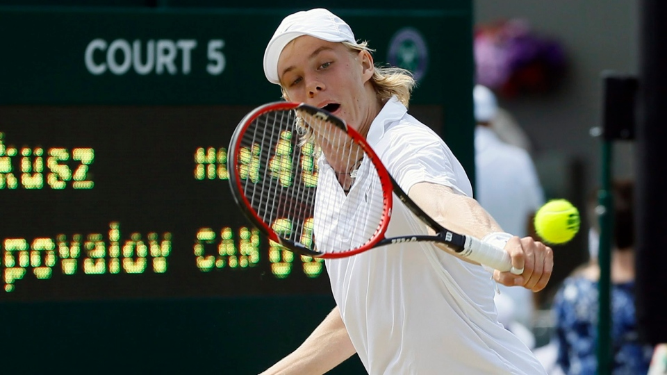 Denis Shapovalov of Canada returns to Mate Valkusz of Hungary during their men's singles match on day eleven of the Wimbledon Tennis Championships in London, Thursday, July 7, 2016. (AP / Kirsty Wigglesworth)