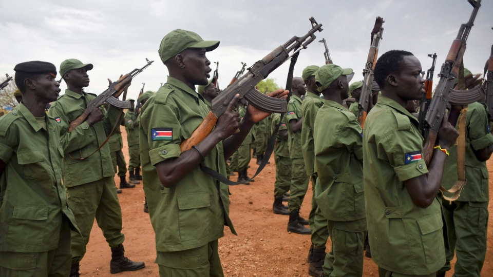 South Sudanese rebel soldiers raise their weapons at a military camp in the capital Juba, South Sudan, Thursday, April 7, 2016.  (Jason Patinkin/AP)