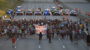 Marchers block part of Interstate 94 in St. Paul, Minn. during a protest sparked by the recent police killings of black men in Minnesota and Louisiana on Saturday, July 9, 2016. (Glen Stubbe / Star Tribune)