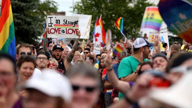 Thousands of people attend the first Pride march in Steinbach, Manitoba, Saturday, July 9, 2016. (THE CANADIAN PRESS / Trevor Hagan)