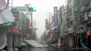In this image made from video, wind-blown debris litters the street from Typhoon Nepartak in Taitung, south eastern Taiwan, Friday, July 8, 2016. (EBC via AP Video)