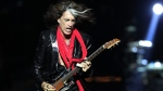 In this Saturday, May 25, 2013 file photo, lead guitarist Joe Perry, of American rock band Aerosmith, performs in Singapore during the inaugural Social Star Awards concert.  (AP / Wong Maye-E, File)