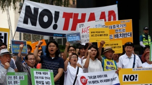 South Koreans shout slogans during a rally to denounce deploying the Terminal High-Altitude Area Defense, or THAAD, near U.S. Embassy in Seoul, South Korea, Monday, July 11, 2016. (AP / Lee Jin-man)