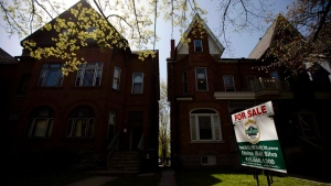 A 'For Sale' sign sits in front of a house, in Toronto, on April 20, 2010. (Darren Calabrese / THE CANADIAN PRESS)