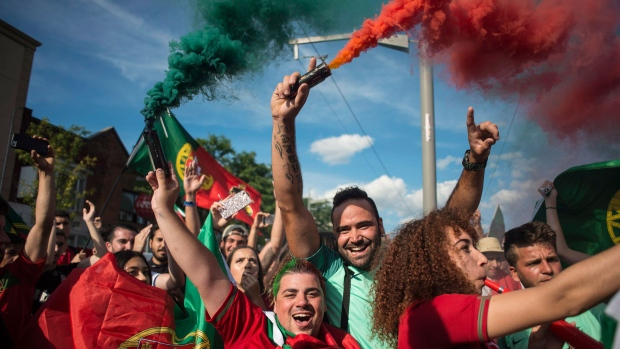 Portuguese soccer fans react after Portugal's victory over France in the Euro 2016 final match, in Toronto on Sunday, July 10, 2016. THE CANADIAN PRESS/Eduardo Lima