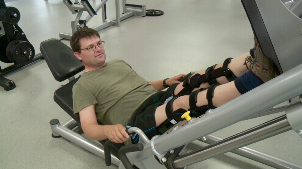 Jean-Philippe Martel tries out his bionic knee braces in Ottawa, July 12, 2016