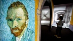 In this  June 15, 2016 file photo, a visitor walks past an image of Van Gogh's Self-Portrait during a press event for the world premiere of the Meet Vincent Van Gogh exhibit in Beijing, China.  (Mark Schiefelbein / THE CANADIAN PRESS / AP)