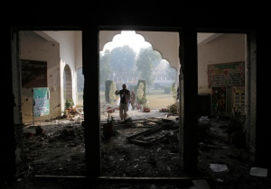 In this Dec. 17, 2014 file photo, a Pakistan army soldier inspects the Army Public School that was attacked a day before by Taliban gunmen, in Peshawar, Pakistan. (AP / B.K. Bangash)