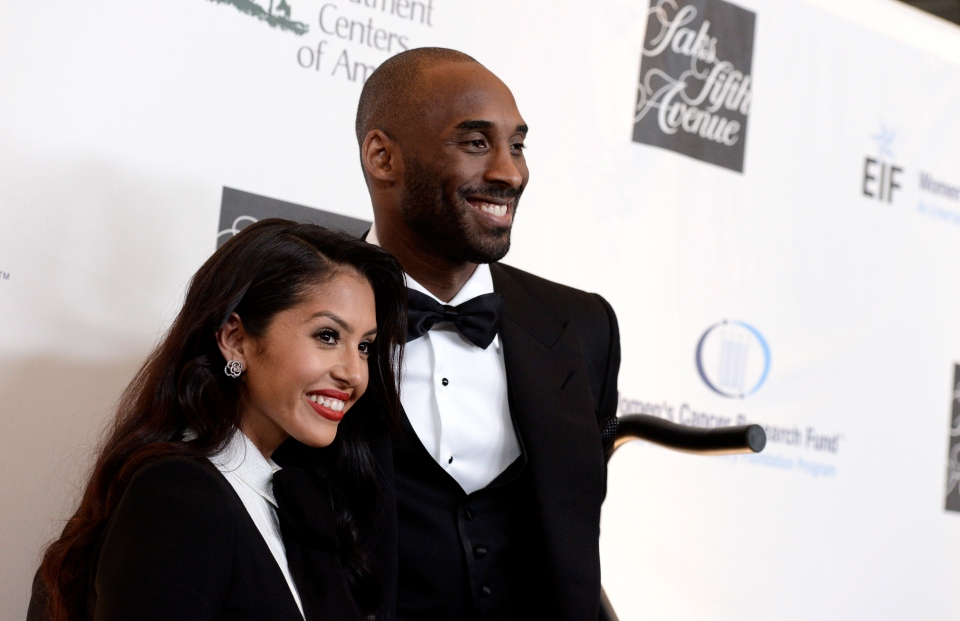 FILE - In this May 2, 2013, file photo, Lakers guard Kobe Bryant, right, and his wife Vanessa Bryant arrive at