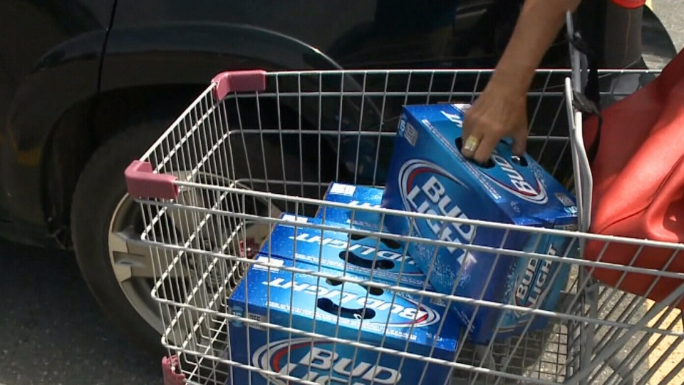 A customer stocks up on cheap beer during a summer promotion in New Brunswick (CTV Atlantic)