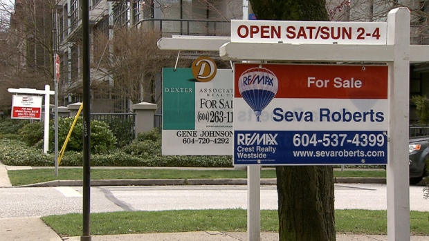 'For sale' signs are seen in Vancouver.
