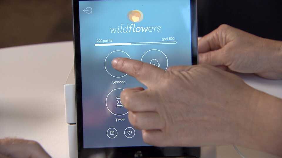 The Wildflowers Mindfulness app measures your heartrate before and after you do one of its meditation sessions.  (CTV)