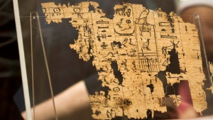 The Egyptian Museum displays one of the oldest papyri in the history of Egyptian writing among the collection of King Khufu papyri discovered at Wadi El-Jarf port. (Amr Nabil/AP Photo)