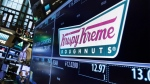 The Crispy Kreme logo appears above its trading post on the floor of the New York Stock Exchange, Monday, May 9, 2016. (AP Photo/Richard Drew)