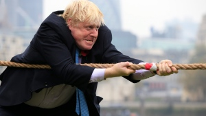 In this file photo, Mayor of London Boris Johnson is shown in action during a tug-of-war contest in London, Tuesday Oct. 27, 2015. (Jonathan Brady / PA via AP)