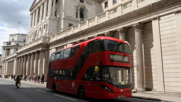 A bus carries passengers past the Bank of England in London on Thursday July 14, 2016. (AP / Adela Suliman)
