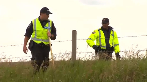 Police spent the day searching a rural area west of the city and say the person in custody may have been in the area briefly.