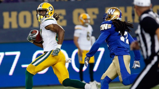 b0ede73750c Reilly throws for 465 yards as Eskimos beat Blue Bombers