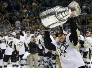 In this June 12, 2016, file photo, Pittsburgh Penguins center Sidney Crosby raises the Stanley Cup after Game 6 of the NHL hockey Stanley Cup Finals against the San Jose Sharks in San Jose, Calif.  (AP / Marcio Jose Sanchez)