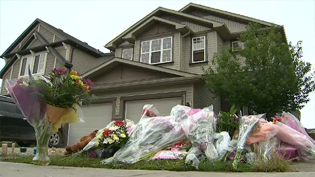 A makeshift memorial sits in front of the northwest home where the mother and daughter lived.