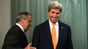 U.S. Secretary of State John Kerry, right, and Russian Foreign Minister Sergey Lavrov arrive to a news conference after their long talks in Moscow, Russia, Friday, July 15, 2016. The United States is offering Russia a broad new military partnership in Syria. (Alexander Zemlianichenko/AP photo)