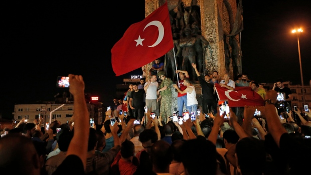 Supporters of Turkey's President Recep Tayyip Erdogan gather waving Turkish flags in Istanbul's Taksim square, early Saturday, July 16, 2016. (AP / Emrah Gurel)