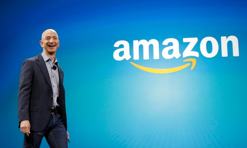 In this June 16, 2014, file photo, Amazon CEO Jeff Bezos walks onstage for the launch of the new Amazon Fire Phone, in Seattle. (AP Photo/Ted S. Warren, File)