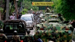 Bangladeshi soldiers ride armoured vehicles as they prepare to raid a restaurant where armed gunmen took hostages in Dhaka, Bangladesh on Saturday, July 2, 2016. (AP)