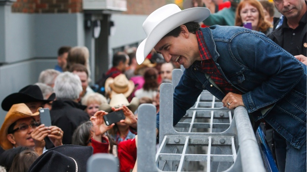 Prime Minister Justin Trudeau shakes hands with guests as he attends a  Stampede breakfast in Calgary 7c8ddf795ed