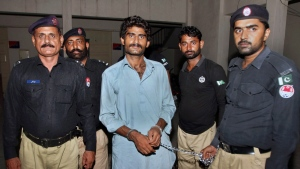 Pakistani police officers present Waseem Azeem, the brother of slain model Qandeel Baloch, before the media following his arrest at a police station in Multan, Pakistan, Sunday, July 17, 2016.  (AP / Asim Tanveer)