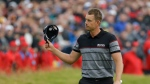 Henrik Stenson of Sweden acknowledges the crowds as he walks on to the 18th green during the final round of the British Open Golf Championship at the Royal Troon Golf Club in Troon, Scotland, Sunday, July 17, 2016. (AP / Matt Dunham)