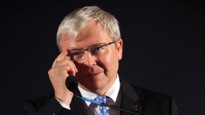 In this Friday, Sept. 6, 2013 file photo, former Australian prime minister Kevin Rudd adjusts his glasses during a speech at a pre-election rally in Mt. Druitt, Australia. (AP / Rob Griffith, File)