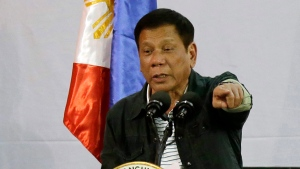 In this June 30, 2016, file photo, Philippine President Rodrigo Duterte gestures as he delivers his speech before a solidarity dinner with the poor event at a slum area in Manila, Philippines. (AP / Aaron Favila, File)