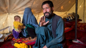 An Afghan man, Mohammad Azam, 45, and father of Zahra, 14, who died after she was set on fire in her husband's home, talks during an interview in a tent in Kabul, Afghanistan, Monday, July 18, 2016. He said his pregnant 14-year-old daughter was burned to death by her in-laws, the latest reported case of violence against women in the country. (AP / Massoud Hossaini)